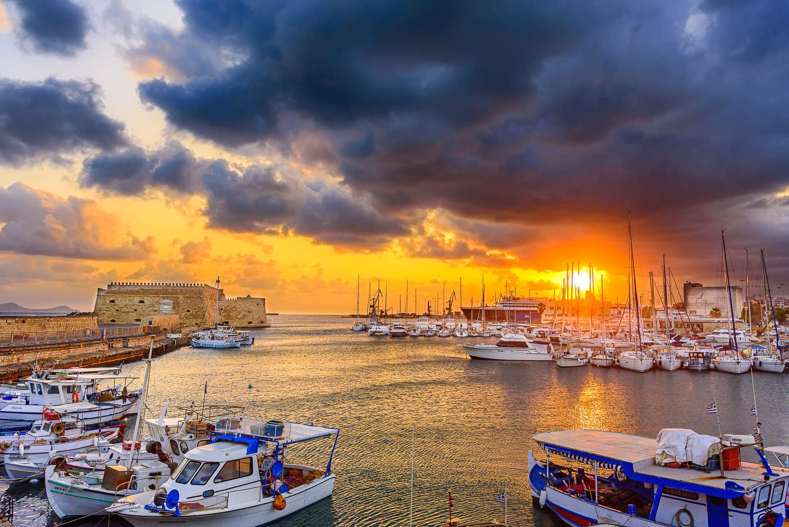A beautiful sunrise at koule fortress in heraklion's port in crete.